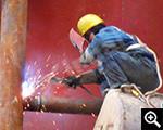 Электросварочная операция монтажных рабочих